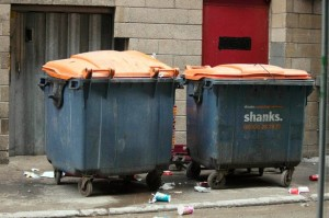 Garbage is crammed into containers